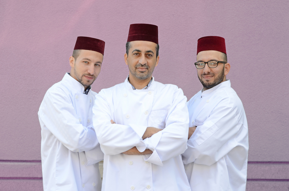 Hazem Alkanakri, Emad AlKarri and Fadi Al Kanakri will cook Syrian food for the Hamilton community at the 12th annual International Marketplace – Taste of the Middle East on December 2 & 3.